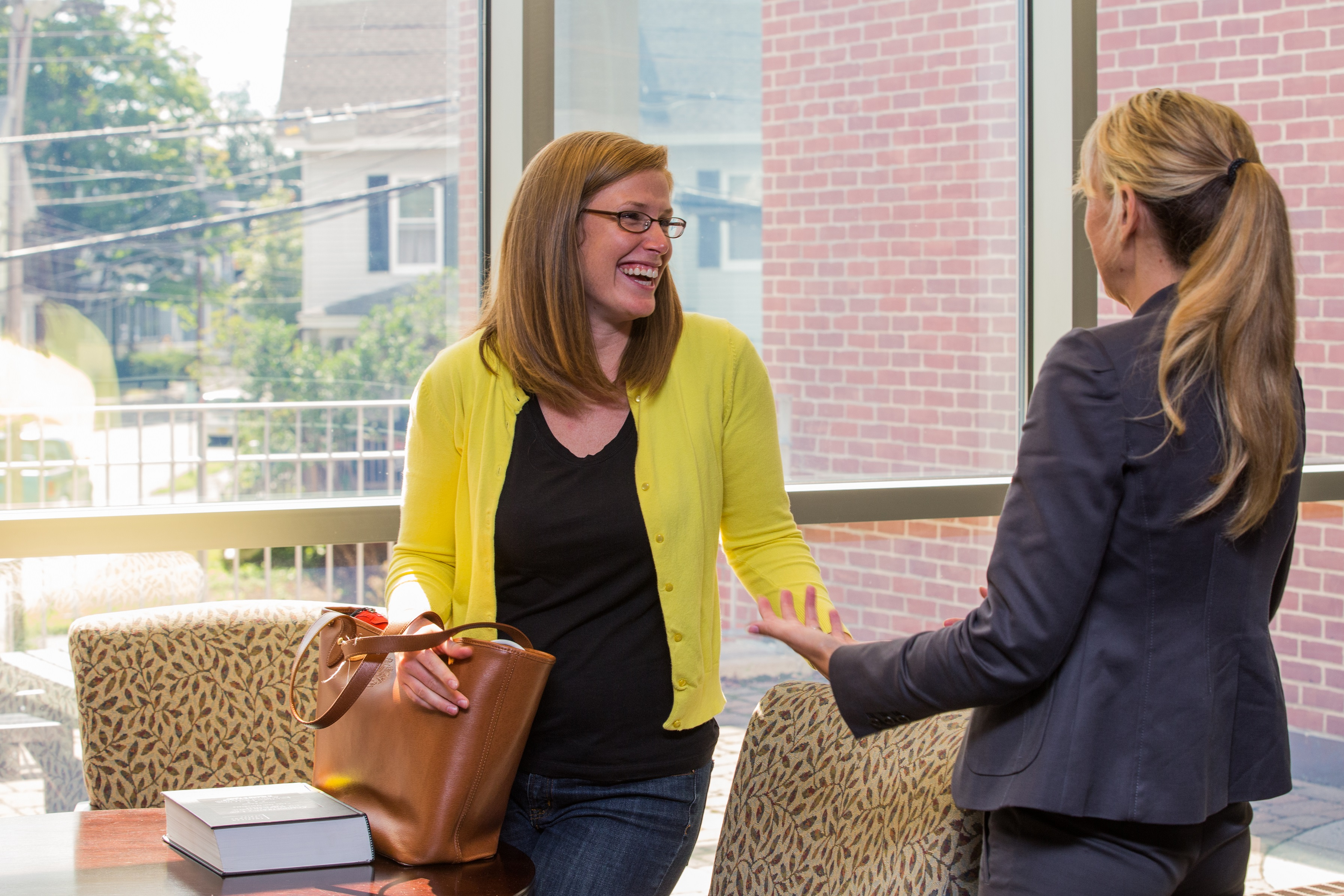 students talking in hallway