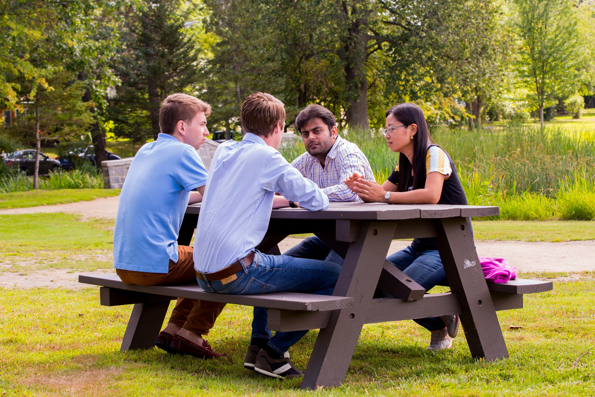 students at picnic table in park