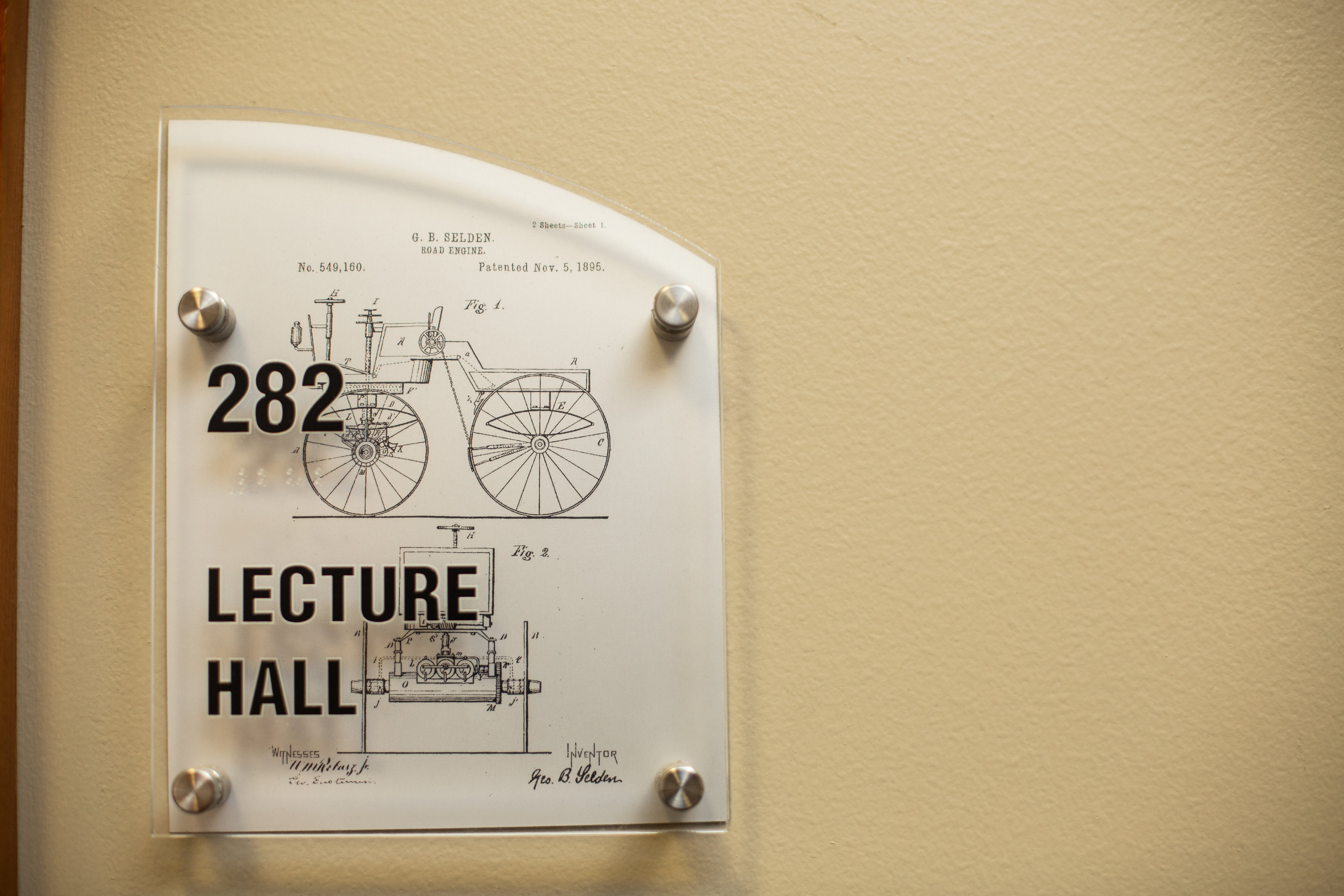 door sign outside lecture hall