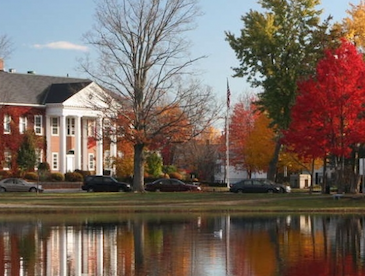 Law campus in fall with pond