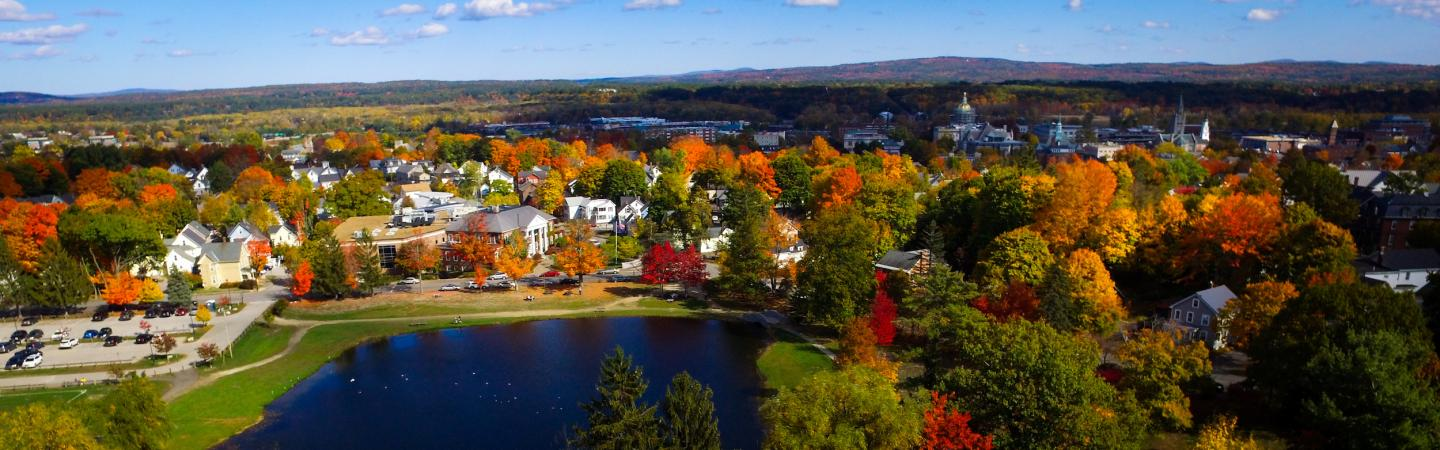 Drone image over White Park, facing the law school, with fall leaves