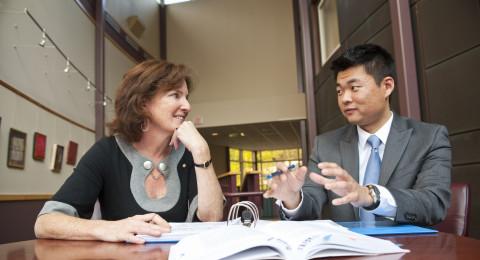 student and professor having conversation