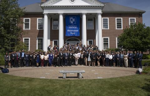 The entering residential JD and graduate program class on the front steps of the school