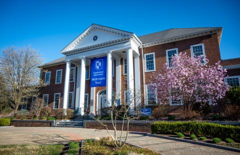 Front lawn in Spring 2021 with welcome banner